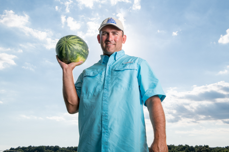 Farmer holding a watermelon