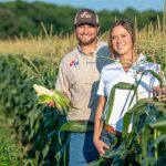 Brother and sister in corn field on family farm family
